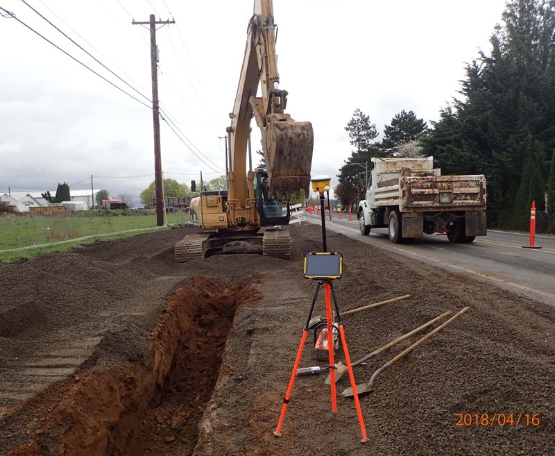 CONTRIBUTED PHOTO - An excavator digs out a trench on the north side of Northeast Sandy Boulevard in Wood Village on Monday, April 16.