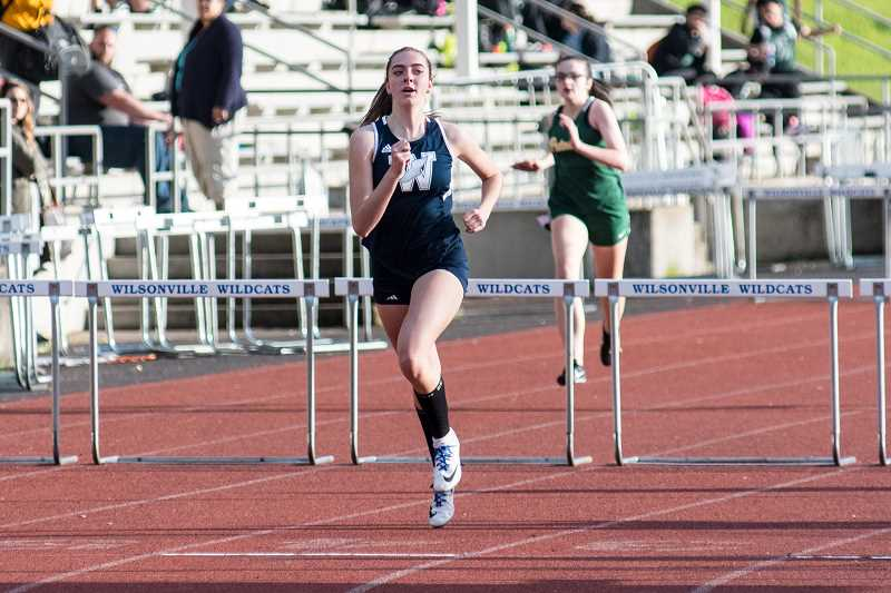SUBMITTED PHOTO: GREG ARTMAN - Junior Emily Scanlan took first place in the 100-meters hurdles and the high jump.