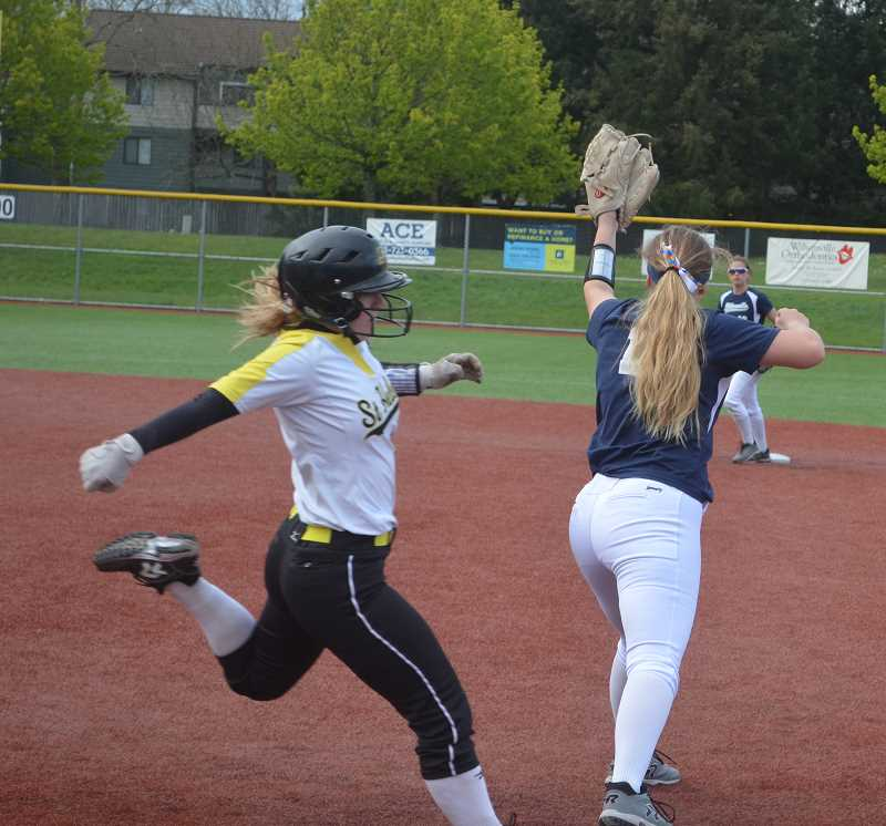 ARCHIVE PHOTO: TANNER RUSS - Firstbaseman Emily Harms catches the ball that tags out a St. Helens runner. Harms has been solid offensively from the plate, and a defensive stalwart in the infield.