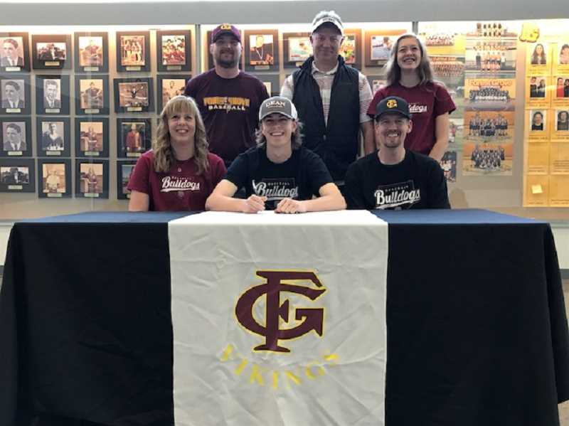 COURTESY PHOTO - Forest Grove's Brayden McLaughlin signed his letter of intent to play baseball at Dean College in Franklin, MA with family, friends and coaches April 25 at Forest Grove High School.