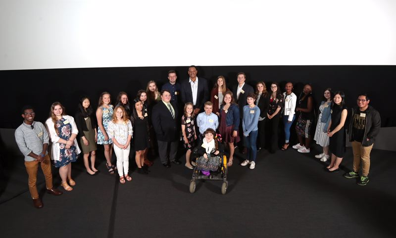 TRIBUNE PHOTO: JAIME VALDEZ - The 2018 Pamplin Media Group Amazing Kids were honored Monday at a ceremony at Oregon Museum of Science and Industry, the fifth-annual such celebration of Oregon young people making a difference. NBA star Brian Grant, the event speaker, stands with them in the center.