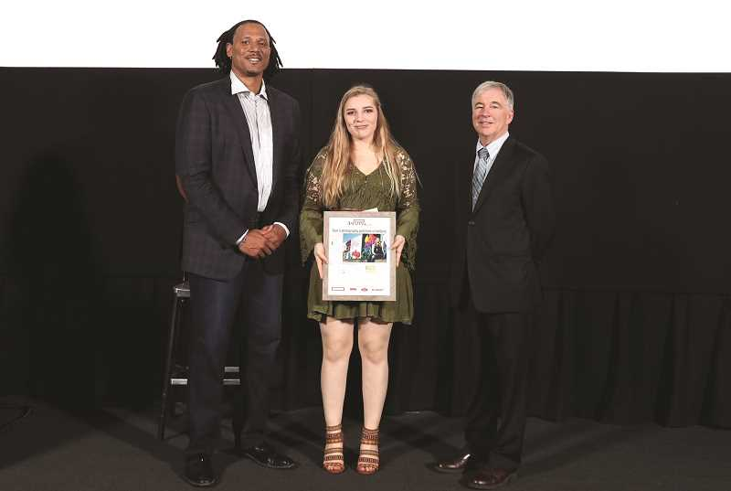 JAIME VALDEZ - Mikayla Golka, Woodburn Independent's 2018 Amazing Kid, is presented with her award by (left) former Trail Blazer and current motivational speaker Brian Grant and Pamplin Media Group President Mark Garber.