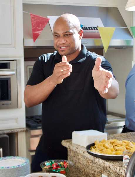 OUTLOOK PHOTO: CHRISTOPHER KEIZUR - Travis Stovall did his best to convince people to vote for his Spanish meatballs during the Try Local Tuesday event.