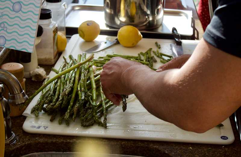 OUTLOOK PHOTO: CHRISTOPHER KEIZUR - Warner Allens team prepares the fresh asparagus to accompany his Golden Whisk-winning dish.