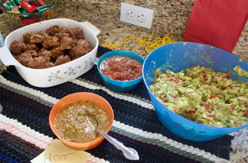 OUTLOOK PHOTO: CHRISTOPHER KEIZUR - One of Travis Stovalls teams biggest selling points was the fresh salsa and guacamole.