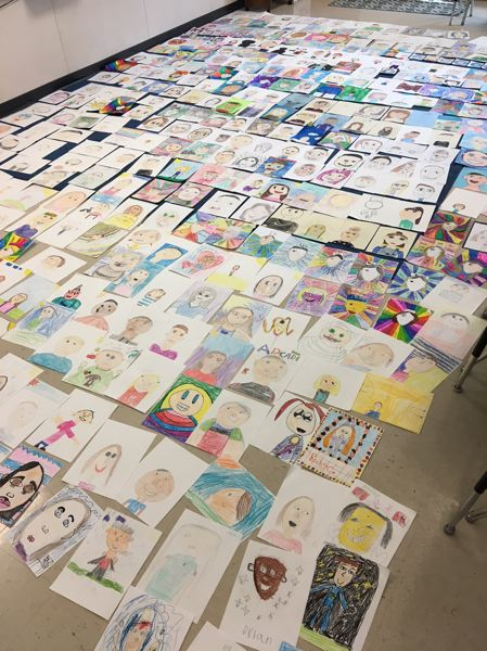 PHOTO COURTESY: LESLIE ROBINETTE - John Wetten students submitted 375 self-portraits demonstrating the diversity of their school community. The effort raised funds to help children in war-torn areas around the world.