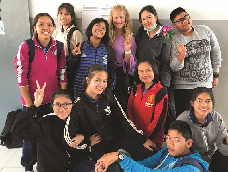 PHOTO COURTESY OF MCKENNA ONTKO - McKenna Ontko spent four months teaching English to 13- and 14-year-old students in Maha Sarakham, Thailand. Pictured is Ontko with some of her favorite, more advanced students on her last day.