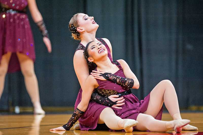 TIMES PHOTO: JOHN LARIVIERE  - Tigard dancer Abby Lam, foreground, with Madison Heniff, helped take their team to the Class 6A Dance and Drill Team championships March 17.