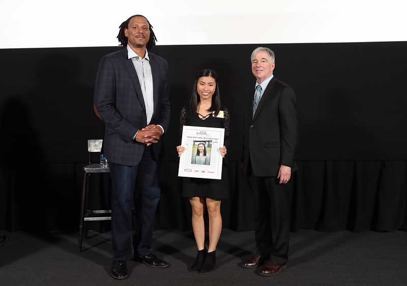 PAMPLIN MEDIA GROUP: JAIME VALDEZ - Tigard's Amazing Kid, Abby Lam, honored along with fellow Amazing Kids during a formal ceremony Monday at OMSI, poses with former Portland Trail Blazers' Brian Grant, left, and Mark Garber, president of Pamplin Media Group.