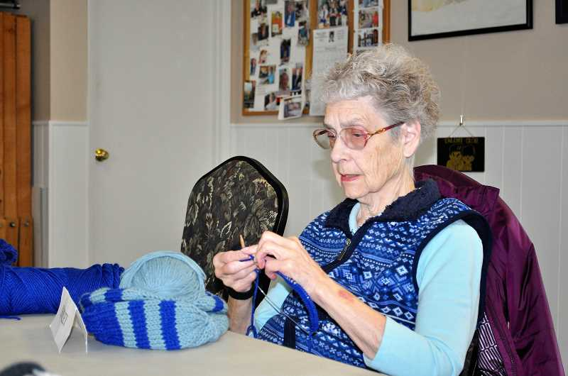 PHOTO: BLAIR STENVICK - Shirley Russell works on a beanie that happens to perfectly match her outfit.