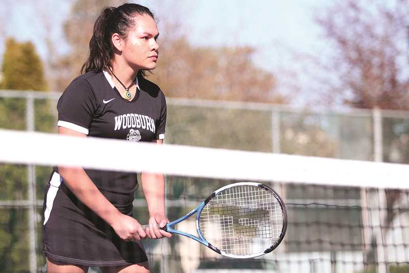 PHIL HAWKINS - Woodburn's Elizabeth Chavez (pictured) and Ana Varillas opened the season as the Bulldog' top doubles team, but are seeing a number of young players within the program challenging for the top spot this year.