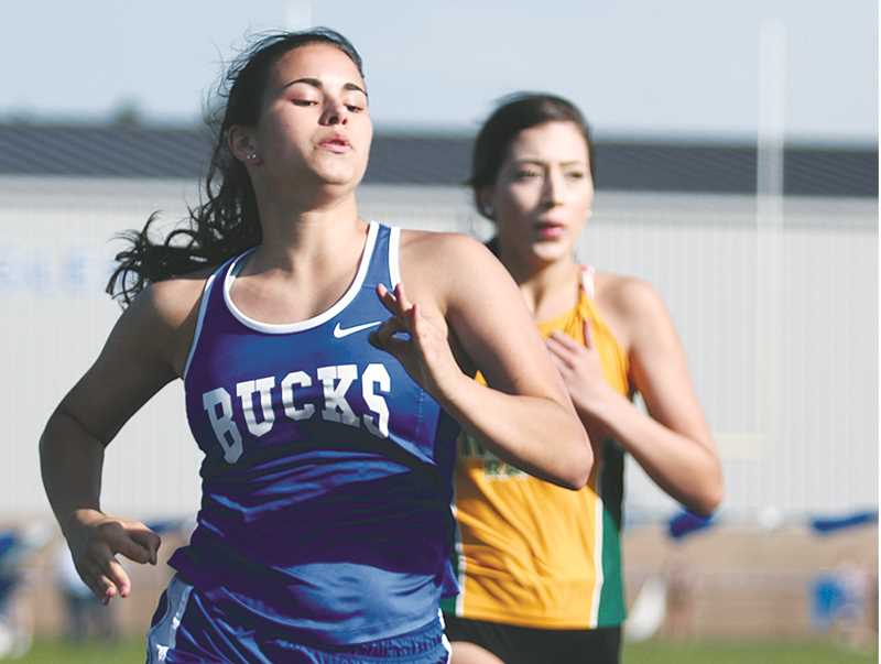 PHIL HAWKINS -- WOODBURN INDEPENDENT - Taysha Veeman was second in the 400 (1:10.19) and fifth in the 100 (13.94) last week as St. Paul hosted a Tri-River/Pac-West meet April 26.