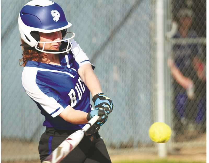 PHIL HAWKINS -- WOODBURN INDEPENDENT - Sadie Smith takes a cut during a doubleheader last week versus Perrydale.