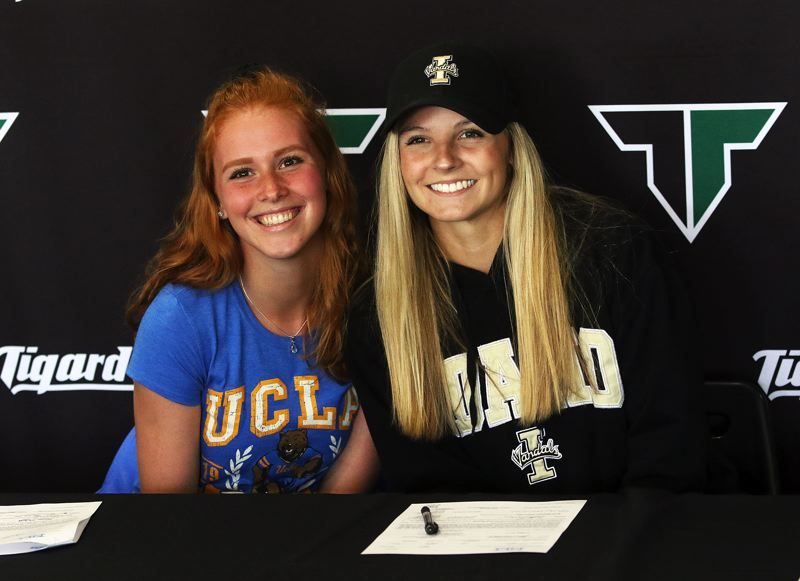 TIMES PHOTO: DAN BROOD - Tigard High School seniors Lauren McFall (left) and Lauren Paven signed their national letters of intent during a ceremony at the school last week.