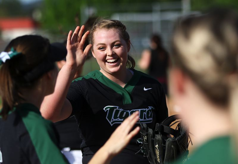 TIMES PHOTO: DAN BROOD - Tigard High School senior pitcher Ashley Davis is all smiles between innings during the Tigers 3-1 win over Sherwood.