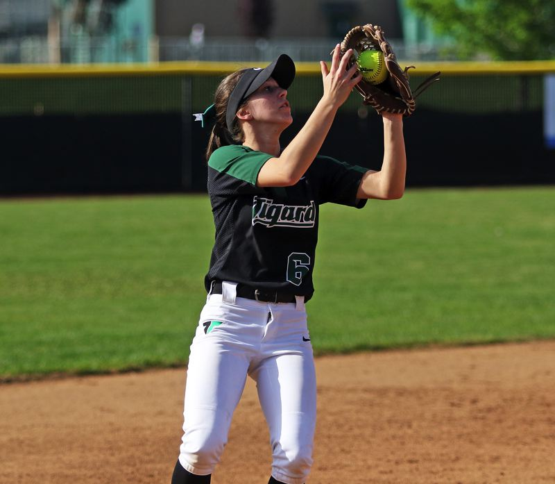 TIMES PHOTO: DAN BROOD - Tigard High School senior shortstop Maddie Hoover catches a pop-up during the Tigers 3-1 win over Sherwood.