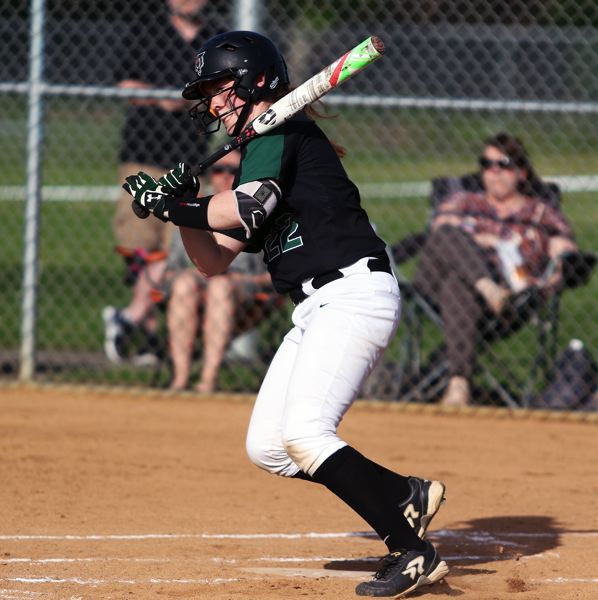 TIMES PHOTO: DAN BROOD - Tigard sophomore Emily Paulson takes a swing during the Tigers' game with Sherwood.