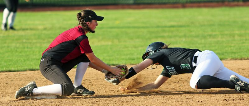 TIMES PHOTO: DAN BROOD - Sherwood sophomore second baseman Emily Knott (left) tags out Tigard sophomore Katelyn Erickson.