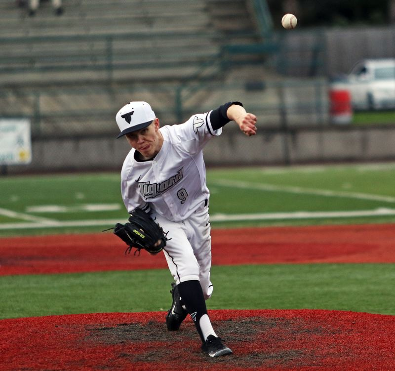 TIMES PHOTO: DAN BROOD - Tigard High School junior Sam Gerkman fires a pitch to the plate during the Tigers 4-0 win over Canby in Fridays Three Rivers League game.