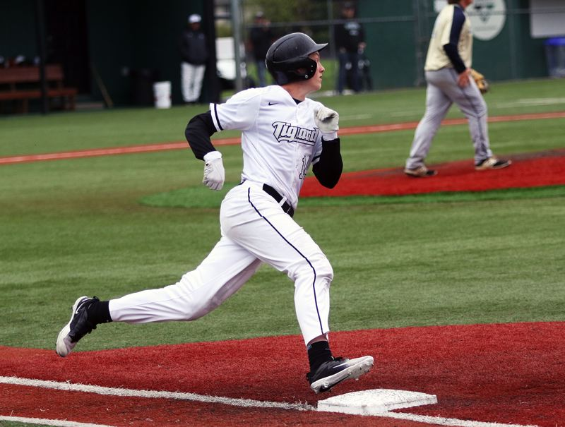 TIMES PHOTO: DAN BROOD - Tigard sophomore Fletcher Ahl gets ready to round first base during the Tigers' 4-0 win over Canby on Friday.