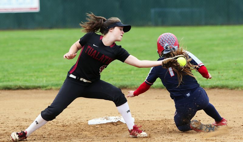 TIMES PHOTO: DAN BROOD - Tualatin sophomore shortstop Bella Valdes (left) tries to tag Westview senior Reece Martin on a stolen base attempt during Saturdays game.