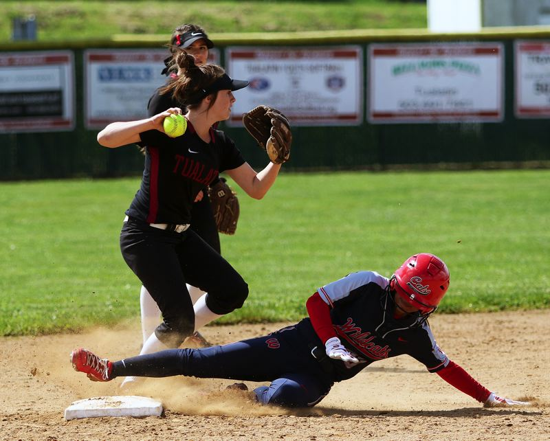 TIMES PHOTO: DAN BROOD - Tualatin sophomore shortstop Bella Valdes looks to make a throw to first base after forcing out Westviews Madeline Curaming at second.