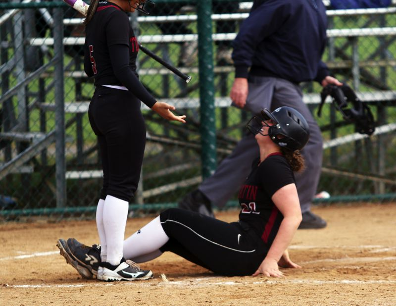 TIMES PHOTO: DAN BROOD - Tualatin junior Emily Johansen smiles after scoring a run during the Wolves' victory over Westview.