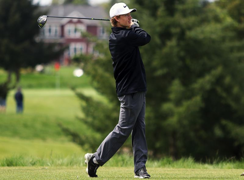 PAMPLIN MEDIA GROUP PHOTO: DAN BROOD - West Linn's Jackson Forsyth watches his tee shot fly during Monday's Three Rivers League district tournament at Stone Creek Golf Course in Oregon City.