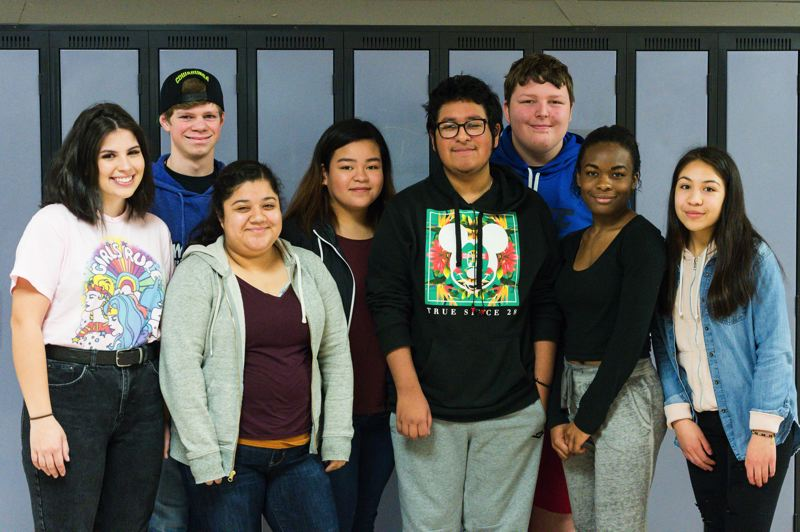 STAFF PHOTO: CHRISTOPHER OERTELL - Pedro Morales (center) poses for a photo with AVID classmates at Forest Grove High School. Morales is recognized by his teachers and peers as a leader and role model who is always willing to help out in any way he can.