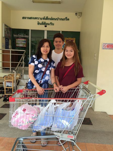 CONTRIBUTED PHOTO: MY TUNGKONGNUCH - My and her mother and brother with items they bought for their Christmas Eve distribution to the homeless.