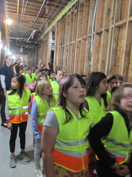 OUTLOOK PHOTO: TERESA CARSON - Troutdale Tigers come down the hall in the new school building and peek into future classrooms.
