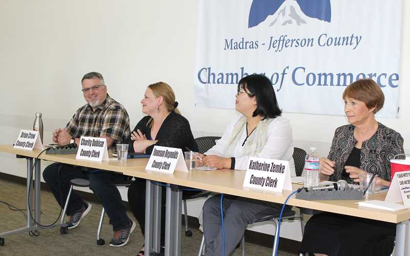 HOLLY GILL/MADRAS PIONEER - From left to right, clerk candidates Brian Crow, Charity Dubisar, Yoonsun Reynolds and Kate Zemke prepare for the April 25 county clerk forum, hosted by the Madras-Jefferson County Chamber of Commerce. Rick Allen and Mike Ahern served as moderators.