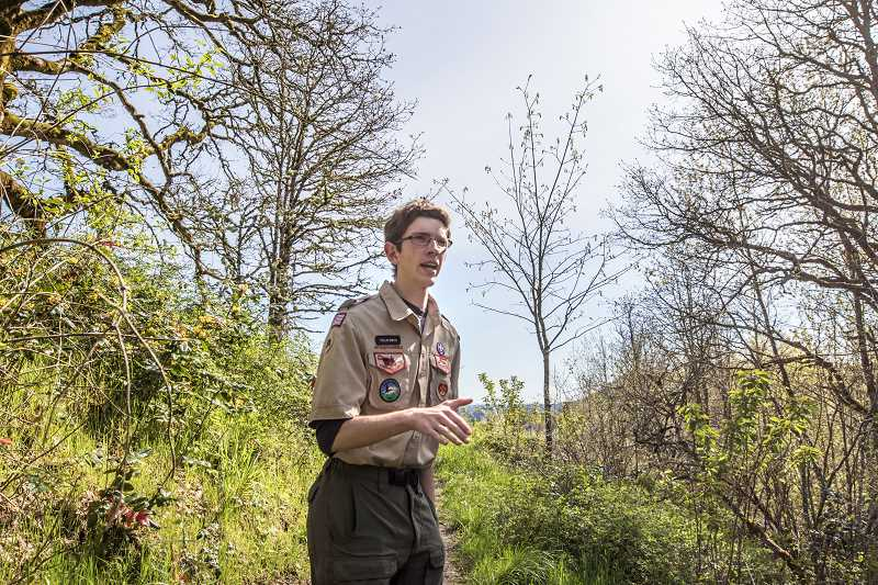 PHOTO BY JONATHAN HOUSE - Eagle Scout Collin Smith talks about his project at White Oak Savanna Park.