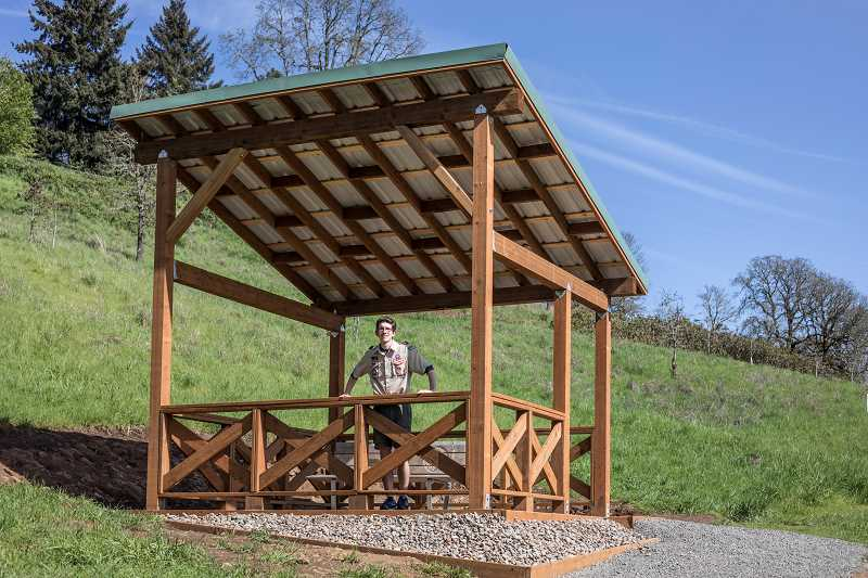 PHOTO BY JONATHAN HOUSE - Eagle Scout Collin Smith with his viewing pavillion project at White Oak Savanna Park.