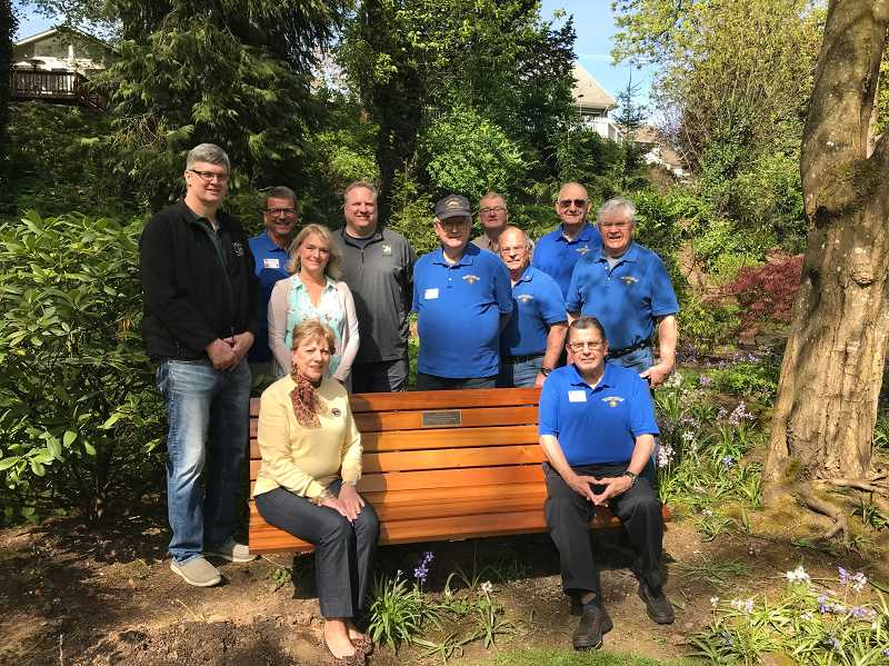TIDINGS PHOTO: PATRICK MALEE - Representatives from the West Linn Lions club, West Linn Parks and Recreation and the McLean House gathered around the newly-installed bench at the McLean House April 24.