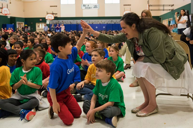 TIMES PHOTO: JONATHAN HOUSE - Findley Elementary School student Christopher Zhong-Yao gets a high five from his teacher Lisa Arcangel after finding out that he won the Doodle 4 Google in Oregon.