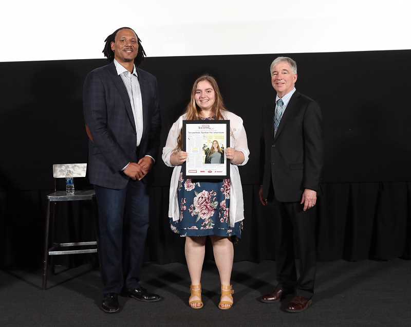 PAMPLIN PHOTO: JAIME VALDEZ - The Pioneer's 2018 Amazing Kid Natalee Litchfield was honored at Pamplin's Amazing Kids celebration at Oregon Museum of Science and Industry on Monday, April 30. She is pictured with former Trail Blazer Brian Grant (left), who was the guest speaker at the event, and Pamplin Media President Mark Garber (right).