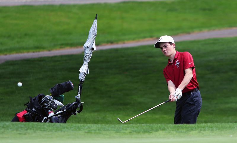 TIMES PHOTO: DAN BROOD - Sherwood High School sophomore Mason Bonn, here chipping onto the green on Monday, won the Three Rivers League individual title.