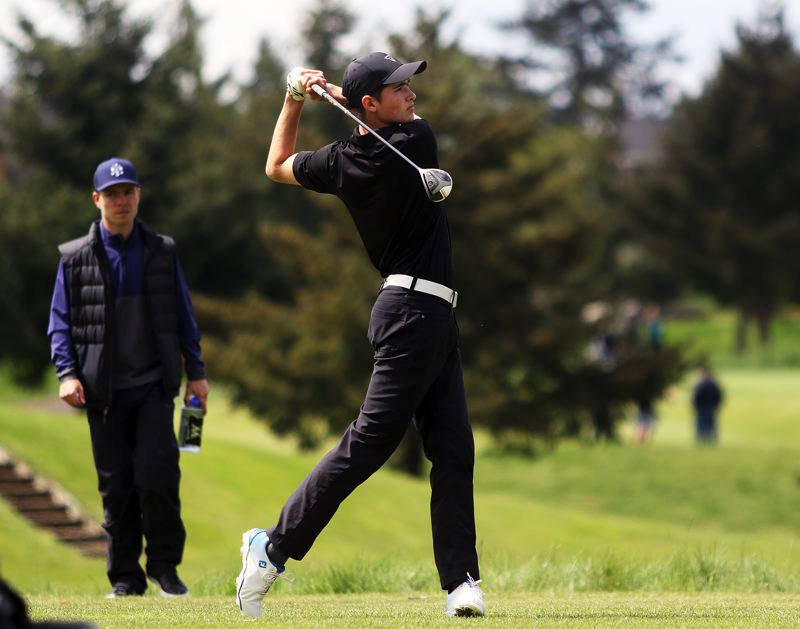 TIMES PHOTO: DAN BROOD - Tigard High School senior Nathan Mallory watches his drive during play Monday at the Three Rivers League district tournament.