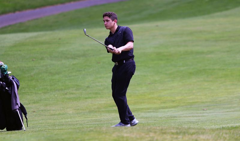 TIMES PHOTO: DAN BROOD - Tigard senior Abel Rodriguez watches his shot during play Monday at the Three Rivers League boys golf district tournament.