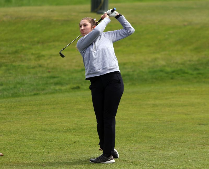 TIMES PHOTO: DAN BROOD - Sherwood sophomore Ally Plusquellec watches her drive during play Monday at the Three Rivers League district tournament.