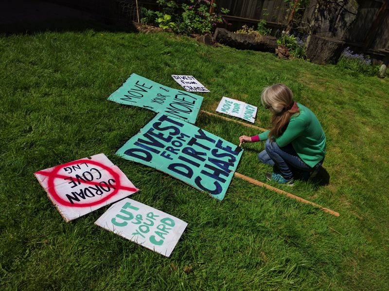 COURTESY 350.PDX - Volunteers prepare signs for protest against Jordan Cove LNG project and Chase Bank.