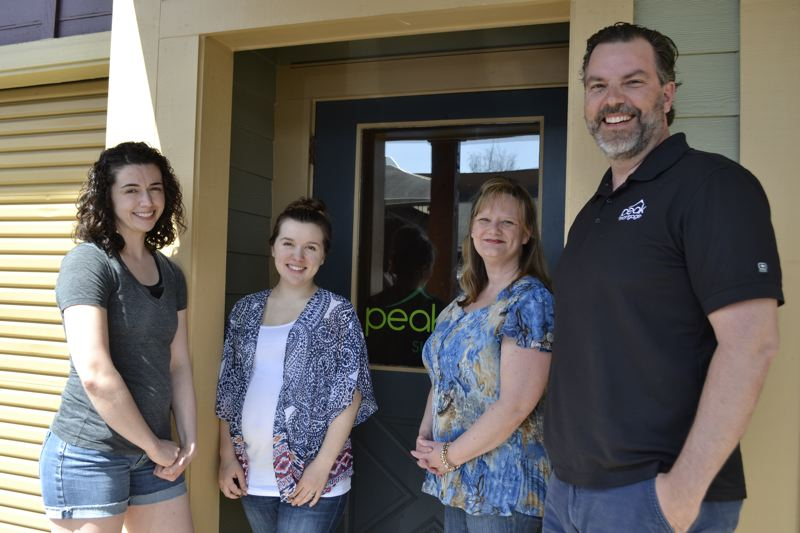POST PHOTO: BRITTANY ALLEN - Allison Roderick, Marissa Lorentson, Paula Siverly and Brian Patterson of Peak Mortgaage in Sandy provide people of differing socioeconomic backgrounds with home loan advice.