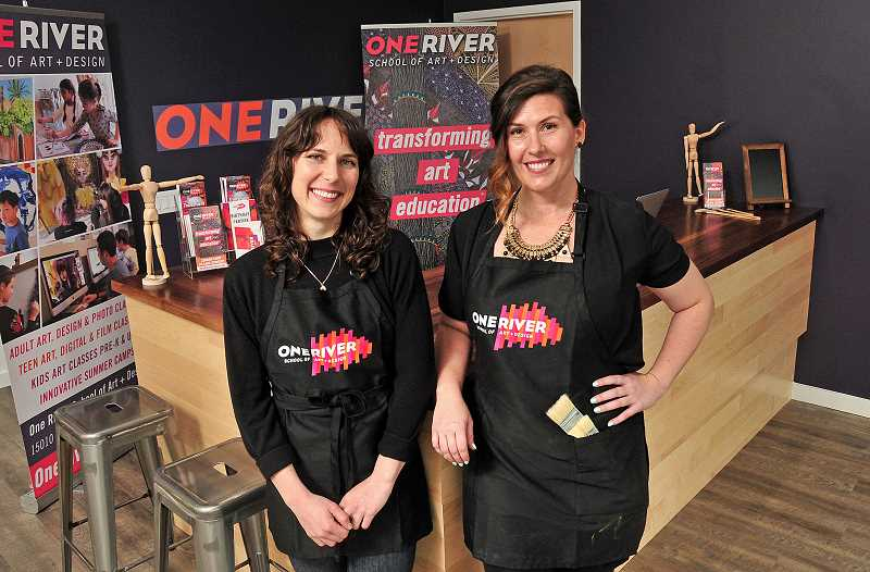 STAFF PHOTOS: VERN UYETAKE  - Director Jessica Schramm (left) and Jenn Playdon, director of art education, stand at the front desk of the new One River School of Art + Design, which will open this weekend in Lake Oswego.