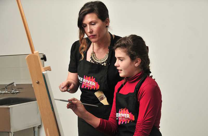"VERN UYETAKE  - Jessica Schramm works with Cadence Schramm during a painting class at the One River School of Art + Design in Lake Oswego. The new school will also offer classes ""they won't get in public school, Schramm says, ""like street art, fashion, anime and contemporary art."""