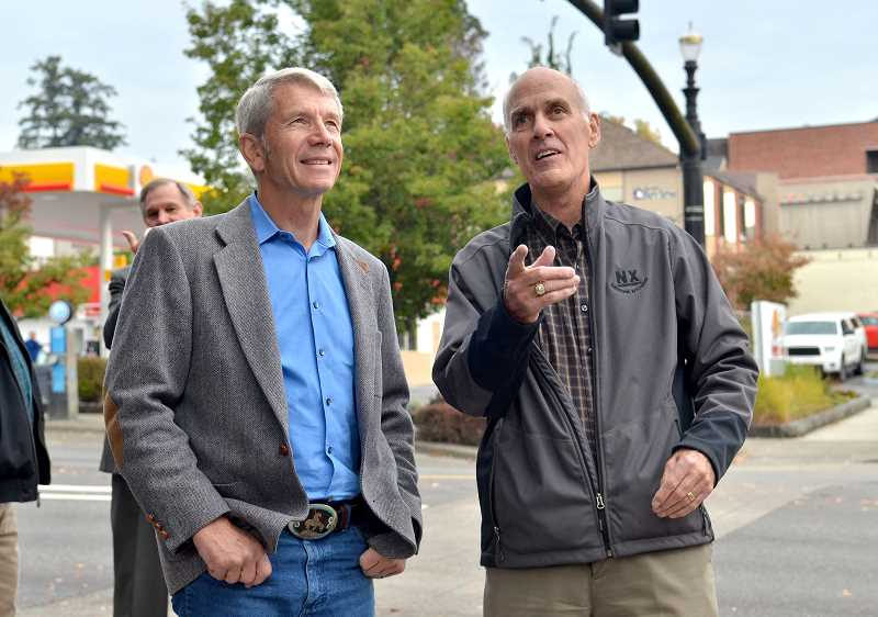 REVIEW PHOTO: VERN UYETAKE - U.S. Rep. Kurt Schrader (left) chats with Mayor Kent Studebaker during a recent walking tour of downtown Lake Oswego. The 5th District congressman has built up a hefty war chest in advance of this years election.