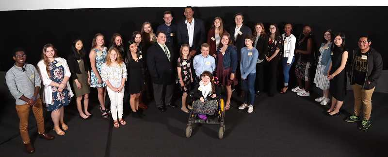 PAMPLIN MEDIA GROUP PHOTO: JAIME VALDEZ - Amazing Kids from across Oregon gather with former Portland Trail Blazer Brian Grant for a group photo at a celebration Monday at the Oregon Museum of Science & Industry. Grant served as emcee for the Pamplin Media Group event, which honored young people whose community service is making a difference where they live.