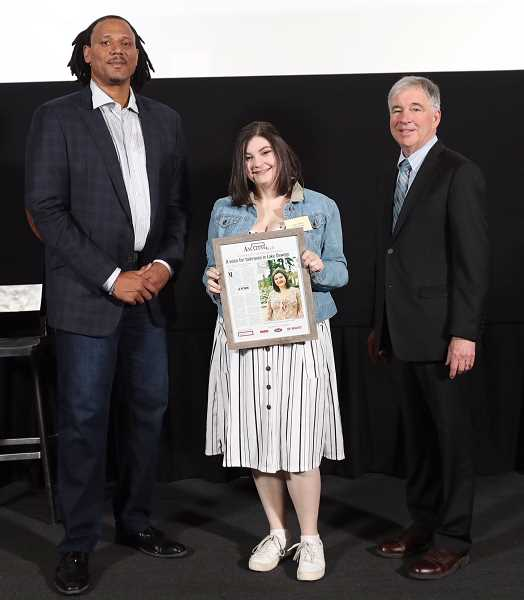 PAMPLIN MEDIA GROUP PHOTO: JAIME VALDEZ - Lake Oswego High School student Margo Sidline, The Review's Amazing Kid for 2018, poses at Monday's celebration with former Portland Trail Blazer Brian Grant and Mark Garber, president and publisher of Pamplin Media Group.