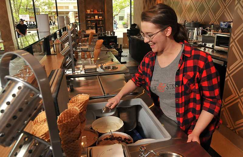 REVIEW PHOTO: VERN UYETAKE - Salt & Straw Marketing Coordinator Amber Hartman makes sure the ice cream is ready for this week's opening of the company's new scoop shop in downtown Lake Oswego. A celebration featuring $1 scoops is planned for Thursday night, followed by an official opening on Friday.