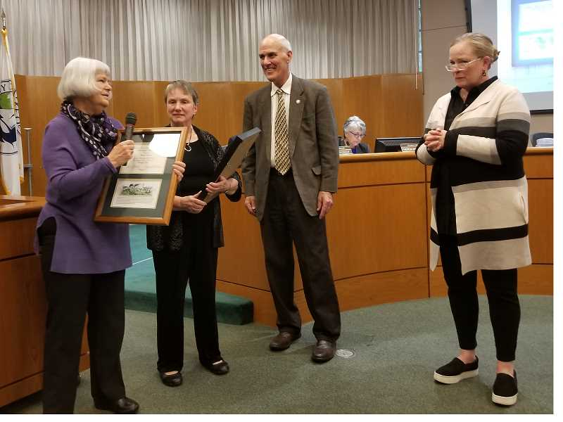 REVIEW PHOTO: ANTHONY MACUK - Karen Davis (left) and Ann Culter were each presented with an Historic Preservation Merit Award on Tuesday by Mayor Kent Studebaker and HRAB Chair Kasey Holwerda.